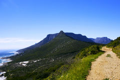 Mountain path less traveled. Sandy Bay mountain path on beautiful winter's day, Cape Town, South Africa Stock Photos