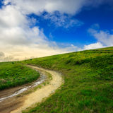 Mountain path uphill to the sky. Summer landscape. mountain path through the field turns uphill to the sky Stock Images