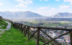 Mountain path with a wooden fence on a blue sky background. The Italian Apennines. royalty free stock photo