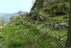 Mountain path with wooden fence Stock Photography