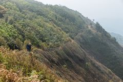 Mountain with pathway to the other side with many mountains with fog in the background at Kew Mae Pan Mountain Ridge. Stock Photography