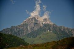 Mountain peak white clouds Royalty Free Stock Photos