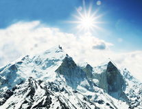 Mountain peak. On sunny background Royalty Free Stock Image