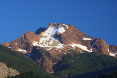 Mountain Peak. One of the Twin Sisters Mountain peaks near Mt Baker. Rocky mountain peak with snow in the summer stock photo