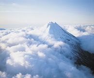 Mountain peak above clouds Royalty Free Stock Photos