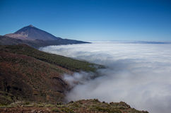 Mountain peak above clouds landscape. Mountain peak, pico del teide above the clouds Stock Photography