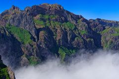 Mountain peak against clear blue sky on sunny day. View from Pico do Arieiro on Portuguese island of Madeira stock photo