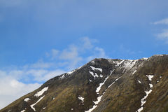 Mountain peak. Against the sky Royalty Free Stock Photography