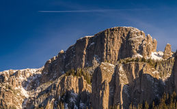 Mountain peak with airplane above Royalty Free Stock Image