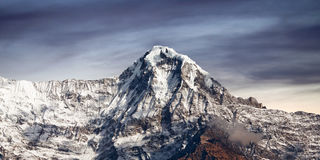Mountain peak in Annapurna South range, Nepal Himalaya. Mountain peak in Annapurna South range in Nepal Himalaya. View from Poon Hill on Annapurna Circuit Trek Stock Photography