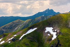 Mountain peak behind the peaks. Lovely scenery of Fagaras mountains on a cloudy summer day stock photo