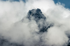 Mountain peak. Behind thick cloud cover Royalty Free Stock Photos
