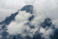 Mountain peak. Behind thick cloud cover Royalty Free Stock Photo