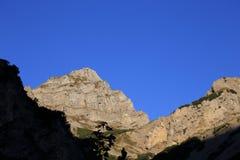 Mountain peak with blue sky Stock Photo