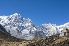 Mountain peak with blue sky in Nepal Royalty Free Stock Images