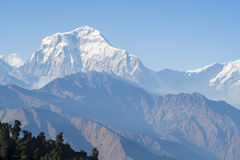 Mountain peak with blue sky in Nepal Stock Images
