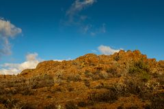 Mountain Peak with cactus vegetation, at Astronomic Observatory in Temisas, Gran Canaria. Mountain peak with cactus, blue sky with white clouds above, at Royalty Free Stock Photos
