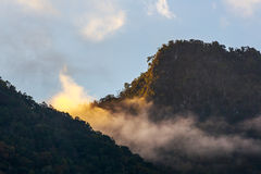 Mountain peak with cloud and fog Royalty Free Stock Image