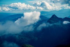 Mountain peak and cloud stock image