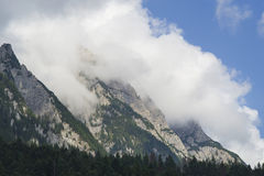 Mountain peak with cloud layer. Rocky mountain peak into the cloud Royalty Free Stock Photography