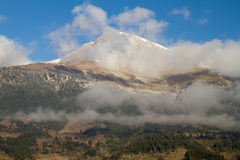 Mountain Peak and Clouds Stock Photography