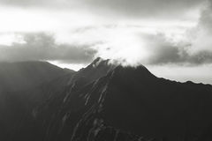 Mountain peak in clouds Royalty Free Stock Images