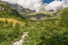 Mountain peak. Clouds circling around Monte Rosa massif Stock Images