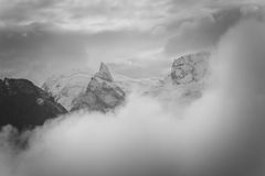 Mountain peak with clouds Royalty Free Stock Photos