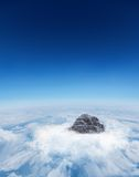 Mountain peak through the clouds Stock Image