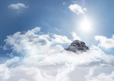 Mountain peak through the clouds Royalty Free Stock Image