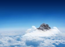 Mountain peak through the clouds Royalty Free Stock Images