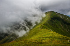 Mountain peak in clouds Stock Image