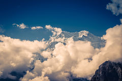 Mountain peak between the clouds. View from the trekking at Annapurnas circuit, Himalaya, Nepal Royalty Free Stock Photography
