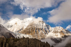 Mountain peak between the clouds. View from the trekking at Annapurnas circuit, Himalaya, Nepal Stock Image