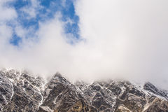 Mountain peak. Cover with cloud Stock Image