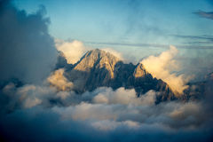 Mountain peak covered in clouds. Dolomites, Italy Royalty Free Stock Photos