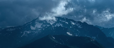 Mountain peak covered by snow at cloudy day. Stock Images