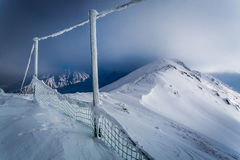 Mountain peak covered with snow in winter Royalty Free Stock Image