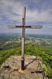 Mountain peak cross with Stock Images
