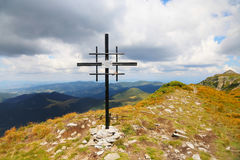 Mountain peak cross in Calimani Mountains, Vf.Negoiu Unguresc, R Royalty Free Stock Photography