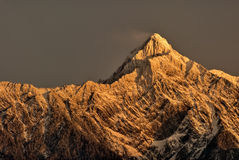 Mountain peak in dawn Stock Photos