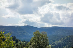 Mountain peak Feldberg with tower - distant view. Black forest trees surrounded Stock Images