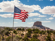 Mountain peak with flag in the foreground Royalty Free Stock Image