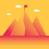 Mountain peak with flag Stock Images