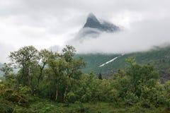 Mountain peak in fog in Innerdalen Stock Photography