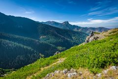 Mountain peak Giewont from between hillocks defile. Royalty Free Stock Photo
