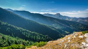 Mountain peak Giewont from between hillocks defile. Tatra Royalty Free Stock Photo