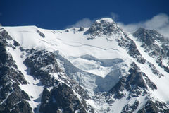 Mountain peak with glacier and snow stock images