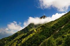 Mountain peak hidden cloud. Royalty Free Stock Photo