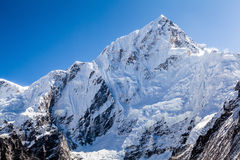 Mountain peak in Himalayas, Nuptse. Mountains landscape in Everest National Park. White snow and avalanche on Nuptse mountain 7864m over Khumbu glacier in Stock Photo